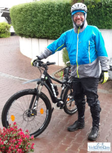 alex-biking-in-the-rain